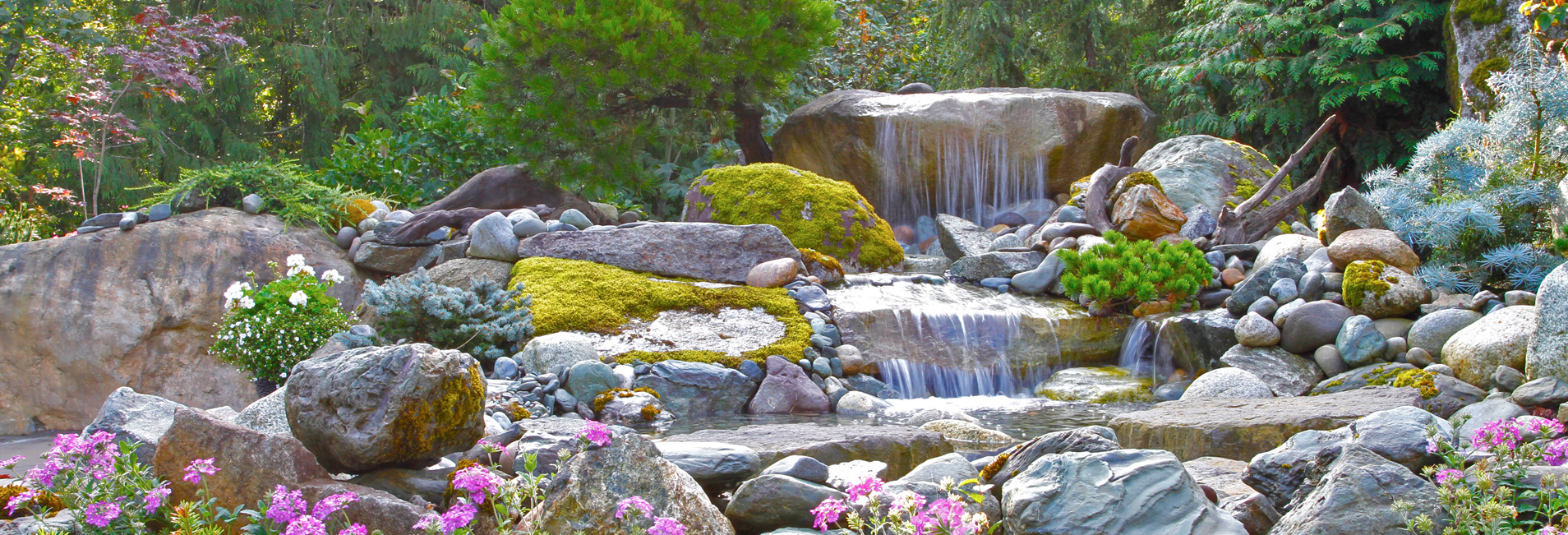 Waterfall with flowers, moss and landscaping